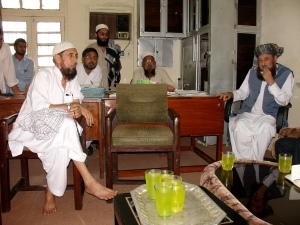Maulana Sami Ul Haq (right) greets guests