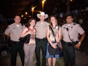 Posing with sheriffs at a rodeo
